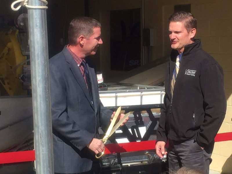 Tuscarawas County Sanitary Engineer, Michael Jones. P.E. (left) and Stark County Sanitary Engineer, James Troike, P.E. (right), preparing for the ribbon cutting